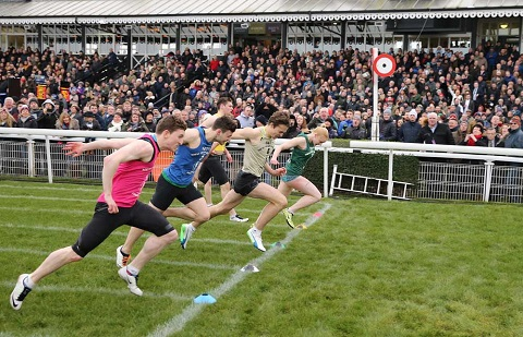 Jazmine Tomlinson (green bib) winning the New Year Sprint from Ryan Houten (beige bib) and Keiran Reilly (red bib)
