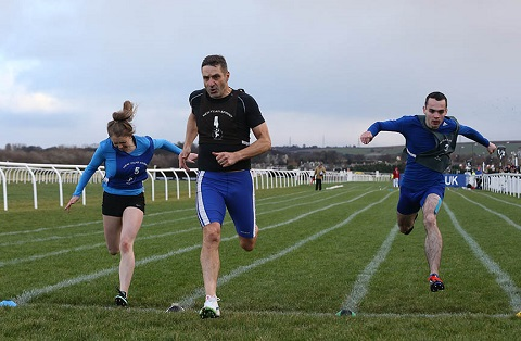 Doug Donald beating Sarah Malone in the third cross-tie with Craig Knowles (green bib) in third.