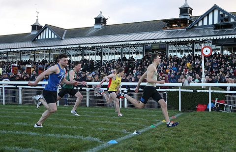 Greg Kelly winning the New Year Sprint from Jordan Charters (blue bib), Emily Dagg (yellow bib) and Cameron Caldwell (obscured by Emily). Calum McWilliam (green bib) was fourth
