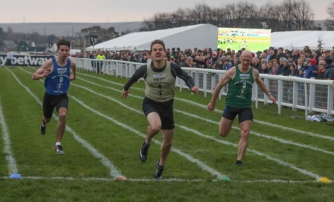 Ian Horsburgh winning the New Year Sprint. Cameron Smith (green bib) was fifth and Douglas Young (bue bib) was sixth.